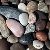 Polished stones on the beach near Rocky Point on the Skeleton Coast