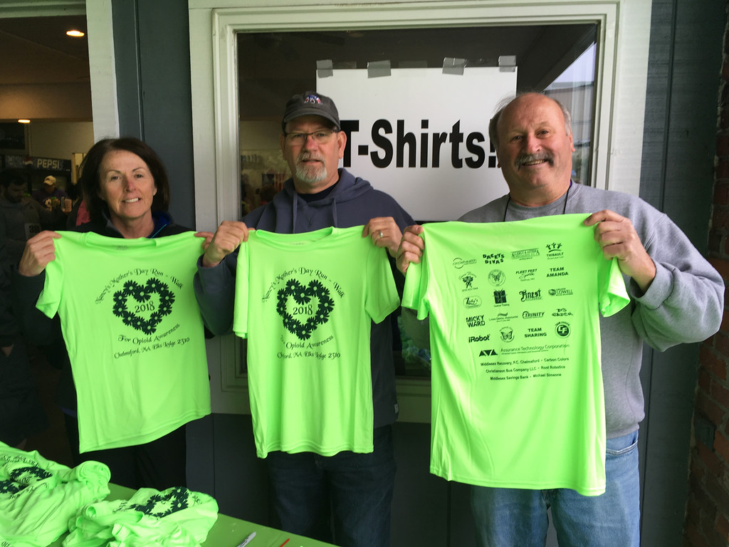 . From left, Jackie Coffey of Chelmsford, Jim Pacheco of Salem and Bruce Donovan of Chelmsford show off the race T-shirts.