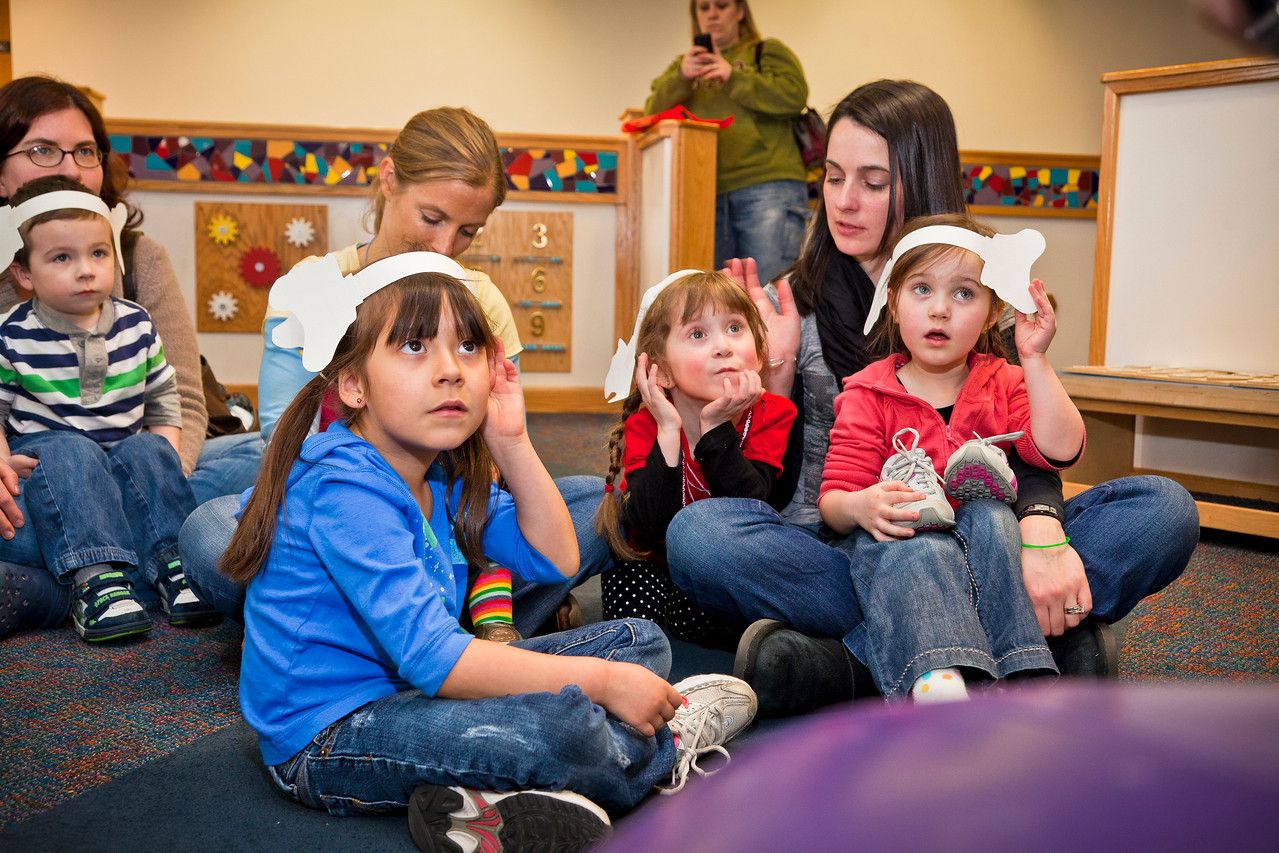 Young children participate in the Horton Senses Something Small activity at the Sciencenter in Ithaca, NY.