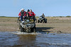 ATV-crossing-river-1,-Nanuk,-Manitoba