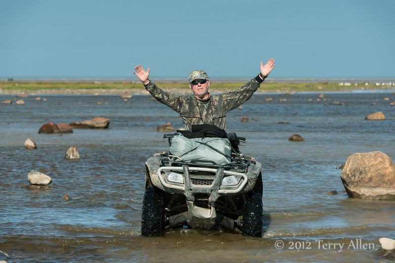 Dennis-on-ATV-in-river-2