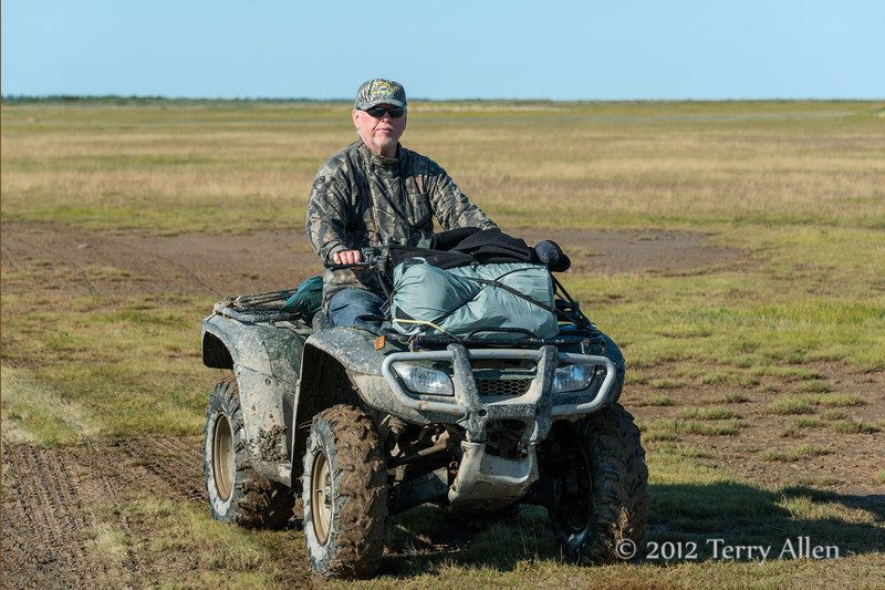 ATV-on-mudflats-2,-Nanuk,-Manitoba