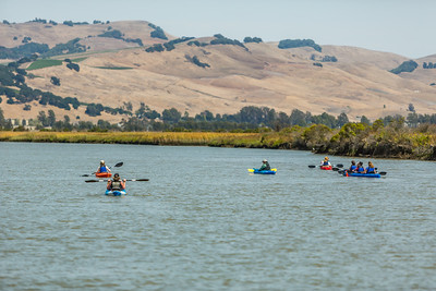 Visitors to the Napa Valley paddle on the Napa River.  Photo courtesy of Napa Valley Vintners