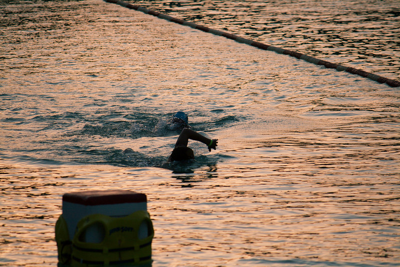 Triathlon entrants doing an early morning warm-up-swim