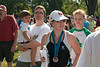Cheri, after the end of the race.  It was over 95 degrees before 9am, making for a brutal race.<br>Cheri's brother Doug, holding his son Gavin, is over Cheri's right shoulder, daughter Megan is over left shoulder.