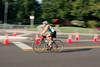 Biker rounding the corner of Jackson and Eagle