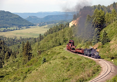 July 9, 2008.  The Durango Railroad Historical Society's restored DRGW 315 climbs Cumbres Pass with a short train. The Chama and Wolf Creek valleys are in the background. The location is actually in Colorado, but Chama, NM is the closest town.