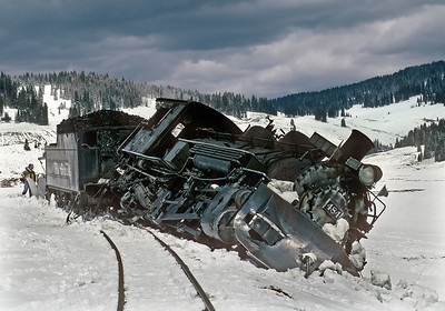 While clearing snow and ice on April 25, 1999 for the spring opening of the railroad, C&TS 484 (lettered DRGW for photo charters) hit ice in the flangeway and derailed just west of Los Pinos tank. Fortunately no one was injured, but the engine was close to rolling over and would not see service again until 2004. This derailment marked the end of using rail equipment (including the rotary) to open the line in the spring, and now the clearing is done by dozers and front end loaders.