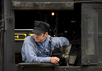 August 24, 2010.  Steam locomotive engineers are supposed to have some gray hair! On the other hand it is great seeing a new generation learn steam railroading. Joe Dailey at age 31 was the old head on this crew, and he was promoted to engineer at age 25!