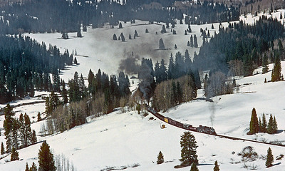May 1997.  After the line has been opened by the rotary and a work train removed the boulder on the tracks near Cascade, our two engine charter freight climbs through the snow toward Coxo crossing.