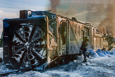 May 1997. Late in the day, after plowing to the top, rotary OY pauses at Cumbres Pass.