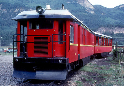 "July 1987.  The D&S acquired this custom built railcar to offer ""local"" service to hikers, fishermen, rafters, kayakers, and anybody else who wanted to ride the train to various points between Rockwood and Elk Park.  It relieved the steam trains of the need to make the local stops.  Operation was dubbed the Animas River Railway so the the D&S could still claim to be 100 percent steam powered.  Unfortunately the motor car turned out to be very unreliable and the service was discontinued after a year or two.  The motor car still is at Durango and reportedly occasionally is used as a switcher.  The trailer was converted into an open car for use on the regular steam trains."
