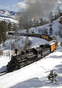 February 13, 2010. The D&S Valentine's Special was run the day before Valentine's Day since the Winter Photographers Special was scheduled for Sunday. Judging from the number of red cars, the proportion of passengers going upscale was pretty high.....gotta impress those Valentines. An afternoon roundtrip to Cascade tied in with a romantic dinner at the historic Strater Hotel upon their return to Durango. The big deal for me since my lovely wife was at home in warm California was the afternoon light on the side of the train at a spot that normally didn't get good light on that side of northbound trains, the curve approaching the highway 550 overpass.