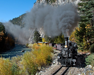 """October 7, 2016.  Southbound past """"Rock Wall"""" on the Silverton branch were the railroad clings to a narrow ledge at the bottom of a shear wall of granite."""
