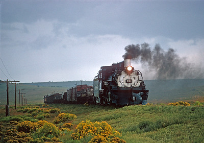 August 29, 1967.  In the last years of the narrow gauge, trains became shorter and less frequent.  Here a relatively short train drifts downhill toward Antonito.
