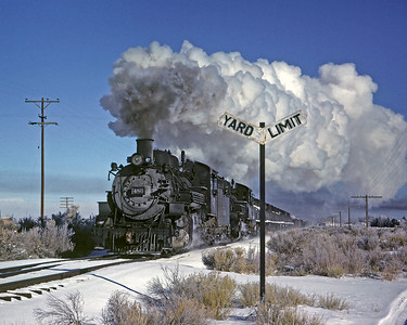 December 18, 1961.  A doubleheader freight passes the west yard board for La Jara enroute Antonito and Chama.