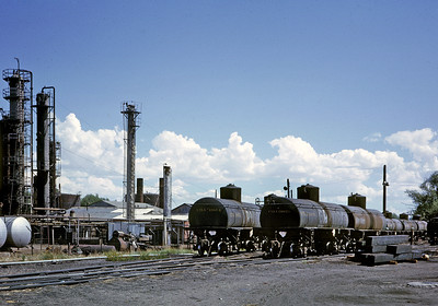 July 1963.  Oriental Refinery in Alamosa.  This small refinery received its crude oil in narrow gauge tank cars loaded at Chama from a pipeline extending to an oil field northwest of town near Chromo.  The crude was important year round business for the railroad, and when the refinery closed the railroad was able to find an excuse to shut down during the winter, greatly increasing the amount of traffic handled by substitute truck service, and hastening the end of rail service.