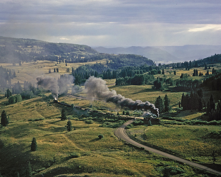 September 1964. A late afternoon Cumbres turn crosses the old unpaved road below Windy Point.