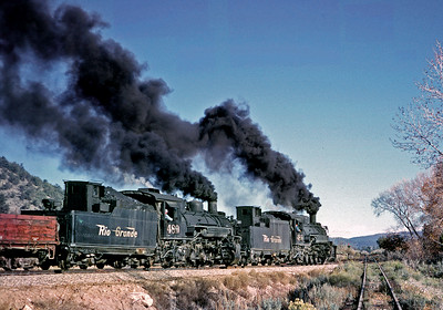 October 1962. An eastbound train leaves the east end of the Navajo Dam relocation and returns to the original line.