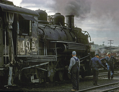 August 29, 1967. The crew of a Chama to Durango train gets ready for departure. This is the next to last year of operation of the narrow gauge by the DRGW,  traffic is down, and the train to Durango is only 30 cars so the 498 can handle it alone.