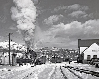 December 20, 1961. A caboose hop leaves Durango headed for Farmington. It will pick up its train at Carbon Junction, where the cars were set out the prior evening by a train from Chama. The caboose, two loaded boxcars, two flats of farm tractors, and a MofW tank car are the only cars from a 50 car train that made it all the way into Durango, the balance were Aztec and Farmington cars that were set out at Carbon Junction. The MofW tank car had been used to fill cisterns at Ignacio and Lumberton on its eastbound trip to Chama two days before.