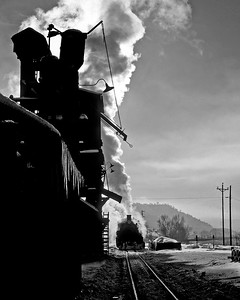 December 1961. The winter sun silouettes the sanding and coaling towers on the Durango roundhouse lead.