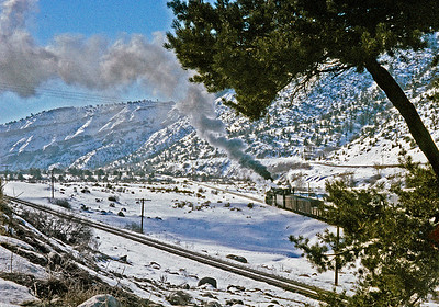 January 31, 1960.  A Farmington turn heads down the branch from Carbon Junction.  The mainline to Chama is in the foreground.