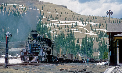 May 28, 1968.  The helper has cut off is is running light down the hill to Chama while the road engine and train do a brake test at the top.