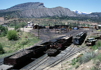 May 29, 1968.  After chasing the train to Navajo we drove to Durango for the night, expecting to chase a Farmington turn the next day.  But after seeing the devastation of the classic facility, we were so discouraged we headed for home. To make way for a new highway the classic Durango yard has been decimated.  The water tank had been torn down a couple of years earlier, now the coaling tower was gone and the yard truncated by a new turning loop.  The only connection between the mainline to Alamosa and the Silverton branch is across the turntable!  But with the mainline doomed, it really made no difference.  Of course, with the benefit of hindsight we should have stayed to chase the Farmington turn, but we were really bummed out by the changes.
