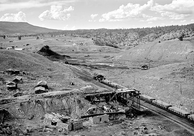 May 28, 1968.  The remains at Monero, a coal mining area.   In the foreground are the ruins of what looks to be a facility for loading railcars on the siding. The railroad had a seperate coaling facility there that was often used to coal eastbound trains, that I believe was around the corner on the single track ahead of the engine in this picture.   The loco refueling facility was used up until the last years of operation.