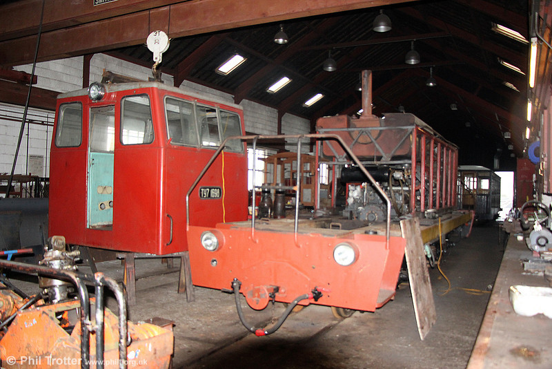 A view inside the Brecon Mountain Railway's workshop at Pant on 6th April 2014. This is Kambarka Machine  4w-4wDH Tu7 1698 of 1981 undergoing a rebuild. The loco came from a Peat Railway at Seda, in Latvia.