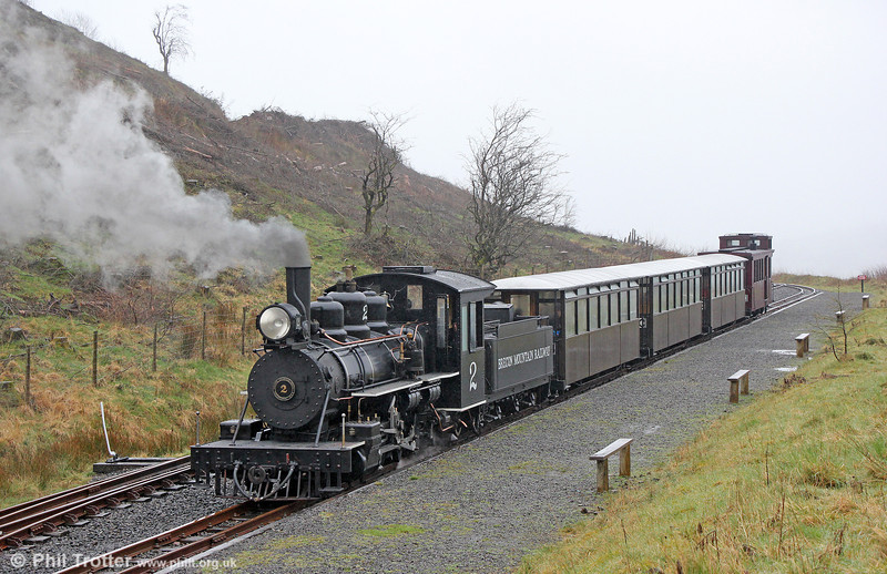 The Brecon Mountain Railway opened its extension to Torpantau on 1st April 2014. For the first time in 50 years it is now possible to catch a train to this remote location. Baldwin 4-6-2 no.2 arrives at Torpantau with the 1030 from Pant on 6th April 2014.