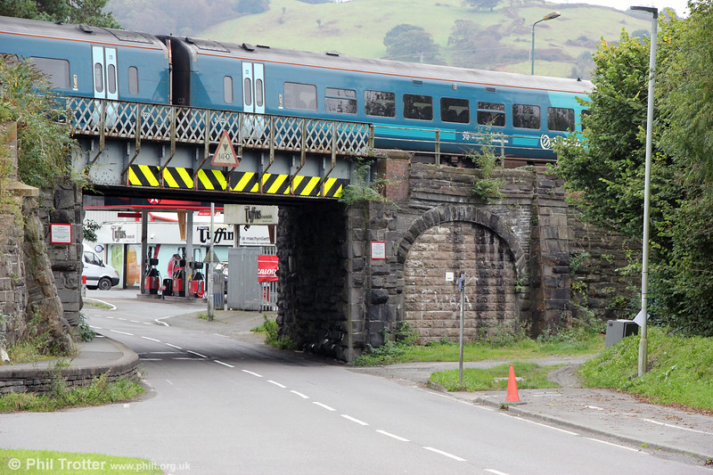 Machynlleth railway bridge - a steel structure on very solid stone abutments. The right-hand blocked up arch originally carried the tramway extension of the Corris Railway to the port of Derwenlas; the extension fell into disuse soon after the standard gauge line was built.