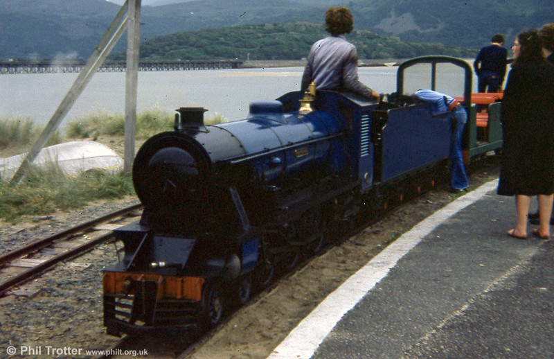 "FR 4-6-2 'Ernest W Twining' at Barmouth Ferry during the 1979 season. This originally worked at Dudley Zoo in the UK before moving to the Fairbourne Railway in 1961. It was a freelance 4-6-2 Pacific tender loco designed by Twining and built by G & S Light Engineering & Maintenance Co., Ltd. in Stourbridge, West Midlands, in 1950 to Works No. 10. Driving wheels are 20"" diameter, with two cylinders of 5 1/16"" diameter, 8"" stroke and piston valves. The locomotive is equipped with steam brakes, and hand brakes on the tender. Bogie tender air brakes and a new boiler were fitted in 1961."