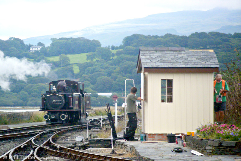 While the railway operates, restoration work goes on! FR 1879-built double Fairlie 0-4-4-0T 'Merddyn Emrys' at Porthmadog on 11th August 2009.
