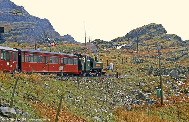 FR ALCO (57156/1916) 2-6-2T 'Mountaineer' heads away towards Blaenau Ffestiniog in May 1986.