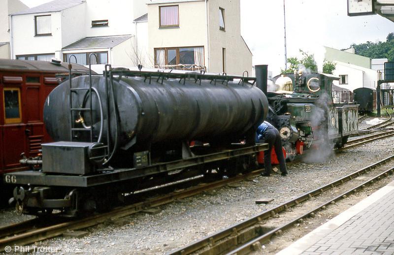 FR Hunslet 2-4-0STT (590/1893) 'Linda' of shunts the railway's oil tanker at Porthmadog in September 1987.