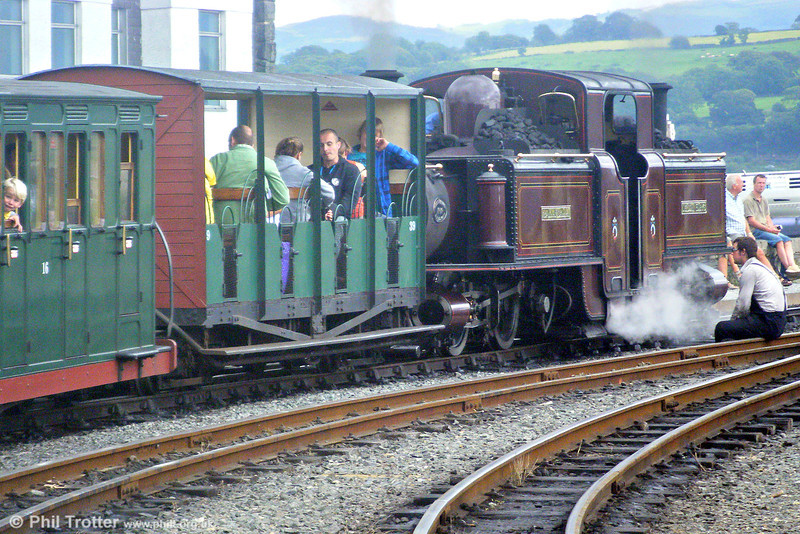 The fireman of double Fairlie 0-4-4-0T 'Merddyn Emrys' awaits departure time from Porthmadog with a train for Blaenau Ffestiniog on 11th August 2009.