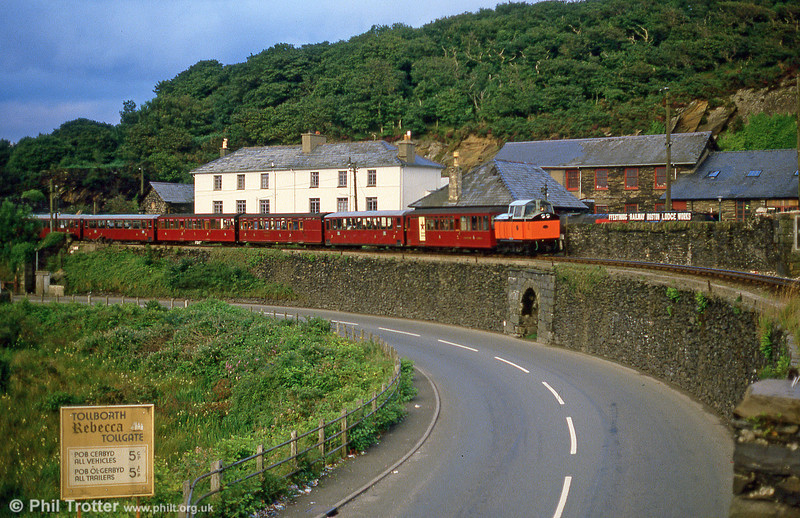Ffestiniog Railway 4wDM 'Conwy Castle/Castell Conwy' (Hibberd 3831/1958) crosses the Cob with an early morning train in September 1987.