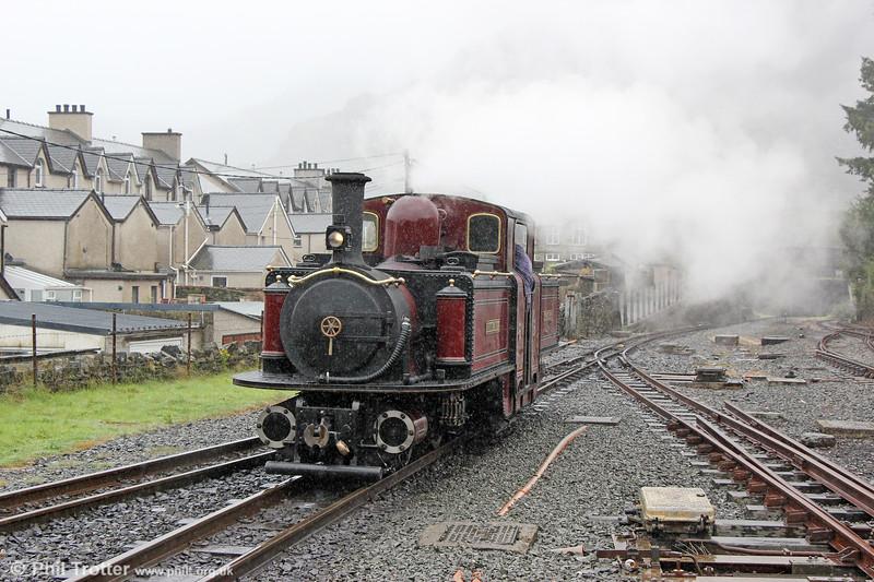 Ffestiniog Railway 0-4-4-0T No.10 (FRCo 1879) 'Merddin Emrys' in filthy weather at Blaenau Ffestiniog on 5th September 2017.