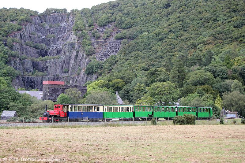 Against a backdrop of the Vivian Slate Quarry, Llanberis Lake Railway Quarry Hunslet (493/1889) 0-4-0ST no. 1 'Elidir' leaves Gilfach Ddu for Llanberis on 5th September 2017.