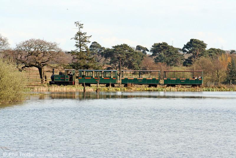 Margam Park Railway 0-4-0DH 'Margam Castle' crosses the dam at New Pond on 5th April 2009.