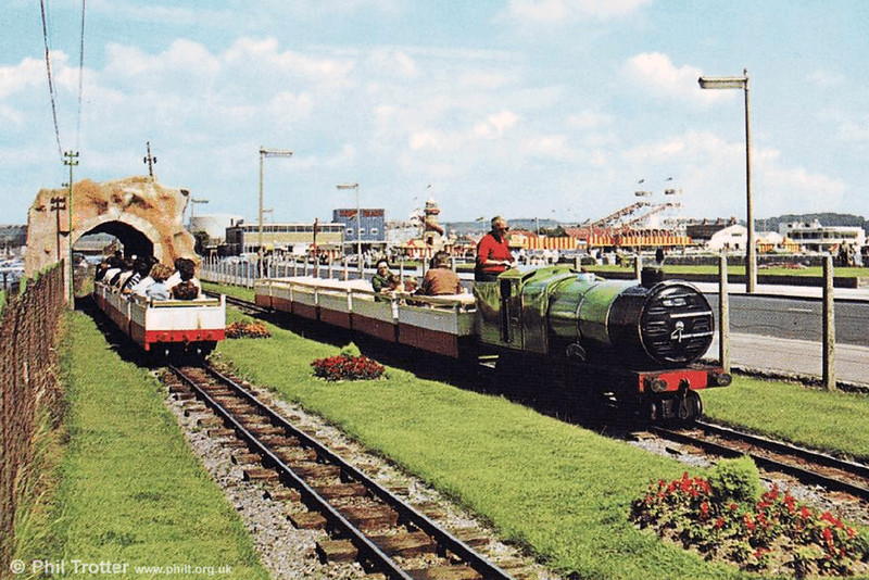 A commercial postcard view of the Porthcawl Miniature Railway with both sets in use, including the shed which served as a 'tunnel' on busy days.