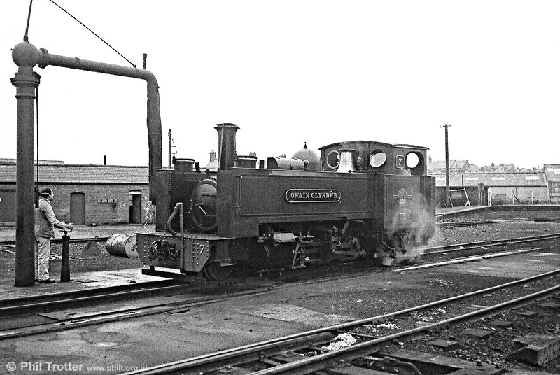 A sequence taken from late BR days: Vale of Rheidol 2-6-2T no. 7 'Owain Glyndwr' takes water at Aberystwyth shed before heading a train for Devil's Bridge.
