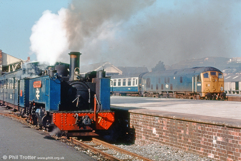 Vale of Rheidol 2-6-2T no. 7 'Owain Glyndwr' waiting to leave Aberystwyth with a train for Devil's Bridge. Class 24 no. 5065  waits alongside. (P.Trotter Collection)