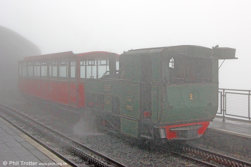 The view from the top of Snowdon is breathtaking (apparently...). SMR SLM (924/1895) 0-4-2RT no. 2 'Enid' at Snowdon Summit on 7th September 2017. Named after the daughter of Laura Alice Duff Assheton-Smith, wife of the major landowner in the area, who cut the first sod in December 1894 in place of her mother, who was ill at the time. It arrived at Llanberis in August 1895 and cost £1,525.