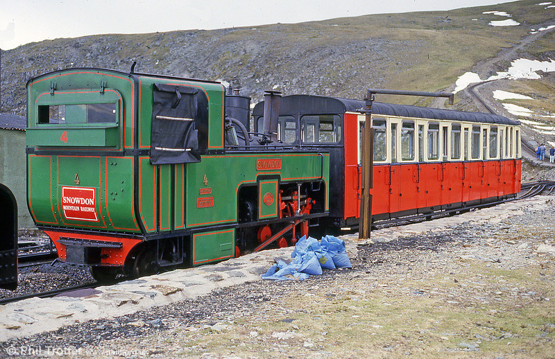 Snowdon locomotive no. 4 'Snowdon' at Clogwyn. The line can be seen disappearing into the snow in the background. This was June 1986 and efforts were being made to try and clear the snow so that trains could reach the summit.