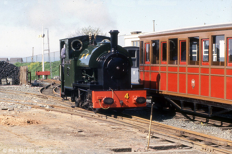 Talyllyn Railway 0-4-2ST no. 4 'Edward Thomas' in the process of running around its train at Tywyn in May 1985.