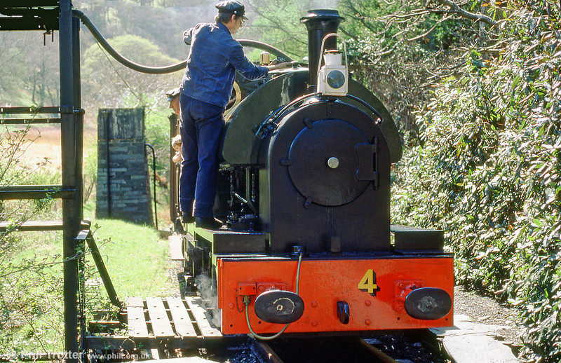 Talyllyn Railway 0-4-2ST no. no. 4 'Edward Thomas' takes water at Dolgoch in May 1985.