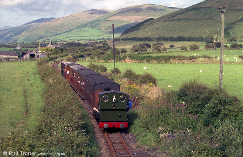 TR 0-4-2ST no. 3 'Sir Haydn' (Hughes 323/1878) is seen approaching Tywyn.